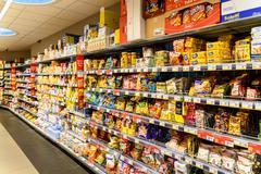 Unhealthy Fast Food Snacks For Sale On Supermarket Shelf Kuvituskuvat