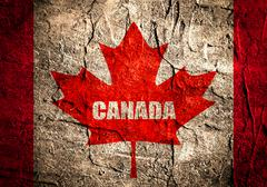 Canada flag maple leaf on grunge backdrop Stock Illustration