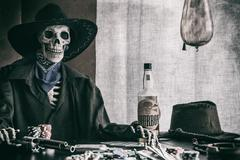 Old West Poker Skeleton Outlaw - stock photo