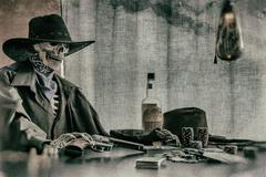 Old West Poker Playing Skeleton Gun - stock photo