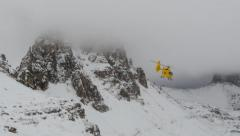 Mountain helicopter snowy dolomites three peaks Stock Footage