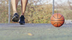 4K Male legs skipping next to a basketball in a playground Stock Footage