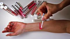 Woman tests cosmetics on a hand Stock Footage