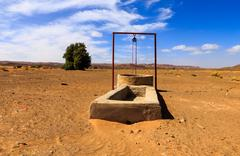 water well in the Sahara desert - stock photo