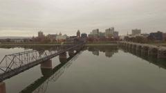 Aerial Zoom from Walking Bridge to Harrisburg. Stock Footage
