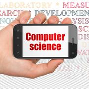 Science concept: Hand Holding Smartphone with Computer Science on display Stock Photos