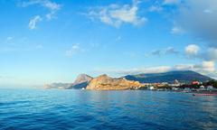 Genoese fortress and summer rocky coastline (Crimea, Ukraine) Stock Photos