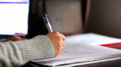 Hand writing, checking and signing documents or student studying - stock footage