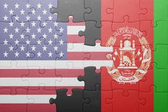puzzle with the national flag of united states of america and afghanistan - stock photo
