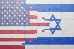 Stock Photo of puzzle with the national flag of united states of america and israel