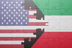 puzzle with the national flag of united states of america and kuwait - stock photo