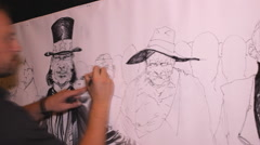 Artist Live Cartoon Uncle Sam Drawing comics on panel canvas Stock Footage