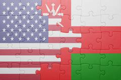 puzzle with the national flag of united states of america and oman - stock photo