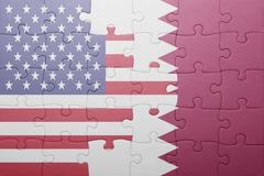 Stock Photo of puzzle with the national flag of united states of america and qatar