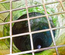Old well with iron grate Stock Photos