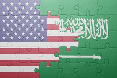 puzzle with the national flag of united states of america and saudi arabia - stock photo