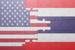 Puzzle with the national flag of united states of america and thailand Kuvituskuvat