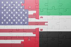 puzzle with the national flag of united states of america and united arab emi - stock photo