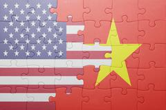 Puzzle with the national flag of united states of america and vietnam Kuvituskuvat