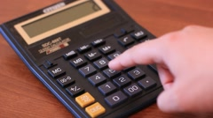 Stock Video Footage of person counting on calculator