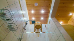 Sauna shower and a bucket of cold water Stock Footage