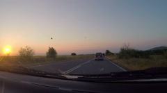 Car on non urban road during sunset, windscreen view Stock Footage