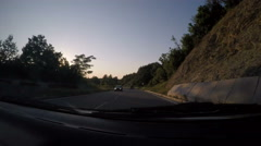 Car on non urban road during sunset, time lapse Stock Footage