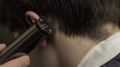 Barber cutting hair with electric clipper Stock Footage