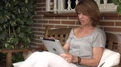 Woman watching her ipad - stock footage