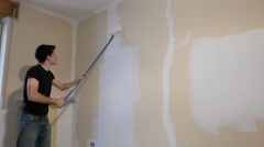 Boy whitening walls with the roller Stock Footage