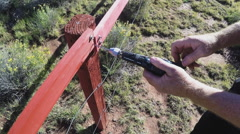 Drilling With Hand Drill On Wooden Fence Stock Footage