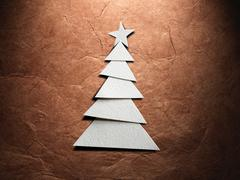Christmas tree cut out from paper - stock photo