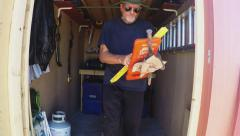 Man Getting Tools From Tool Shed Stock Footage