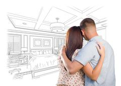 Curious Young Military Couple Looking Over Custom Bedroom Design Drawing. Stock Photos
