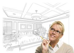 Woman With Pencil Over Bedroom Design Drawing and Photo Combination - stock photo