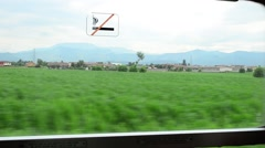 View on the fields and vineyards from high-speed train Milan - Venice Stock Footage