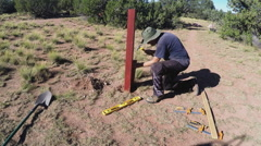 Packing Dirt Around Fence Post In Hole Stock Footage