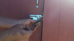 Unlocking Shed Door With Padlock Stock Footage