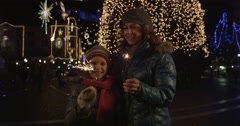 Mother And Daughter Out On Christmas Eve - stock footage