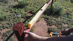 Using Level To Adjust Angle Of Wooden Fence Board Stock Footage