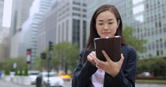 Asian business woman in New York City using tablet computer - stock footage