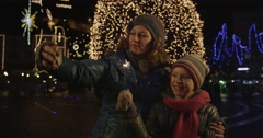 Mother And Daughter On The Phone On Christmas Eve Stock Footage