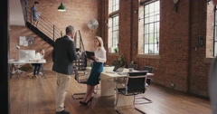 Informal business meeting in shared workspace Stock Footage