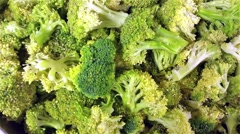 Lots of green broccoli, Brassica oleracea, at a restaurant kitchen Stock Footage