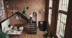 Crane shot in busy office open plan boardroom area - stock footage