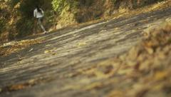 Close up of feet of a runner, running in autumn leaves. Training exercise Stock Footage