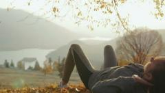 Sporty women exercising abs outside. Beautiful autumn sunset - stock footage