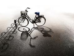 Bike parked in bicycle rack - stock photo