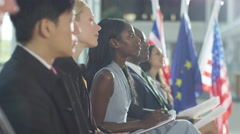 4K Business group listening to the speaker at international conference - stock footage