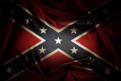 Closeup of silky Confederate flag - stock photo
